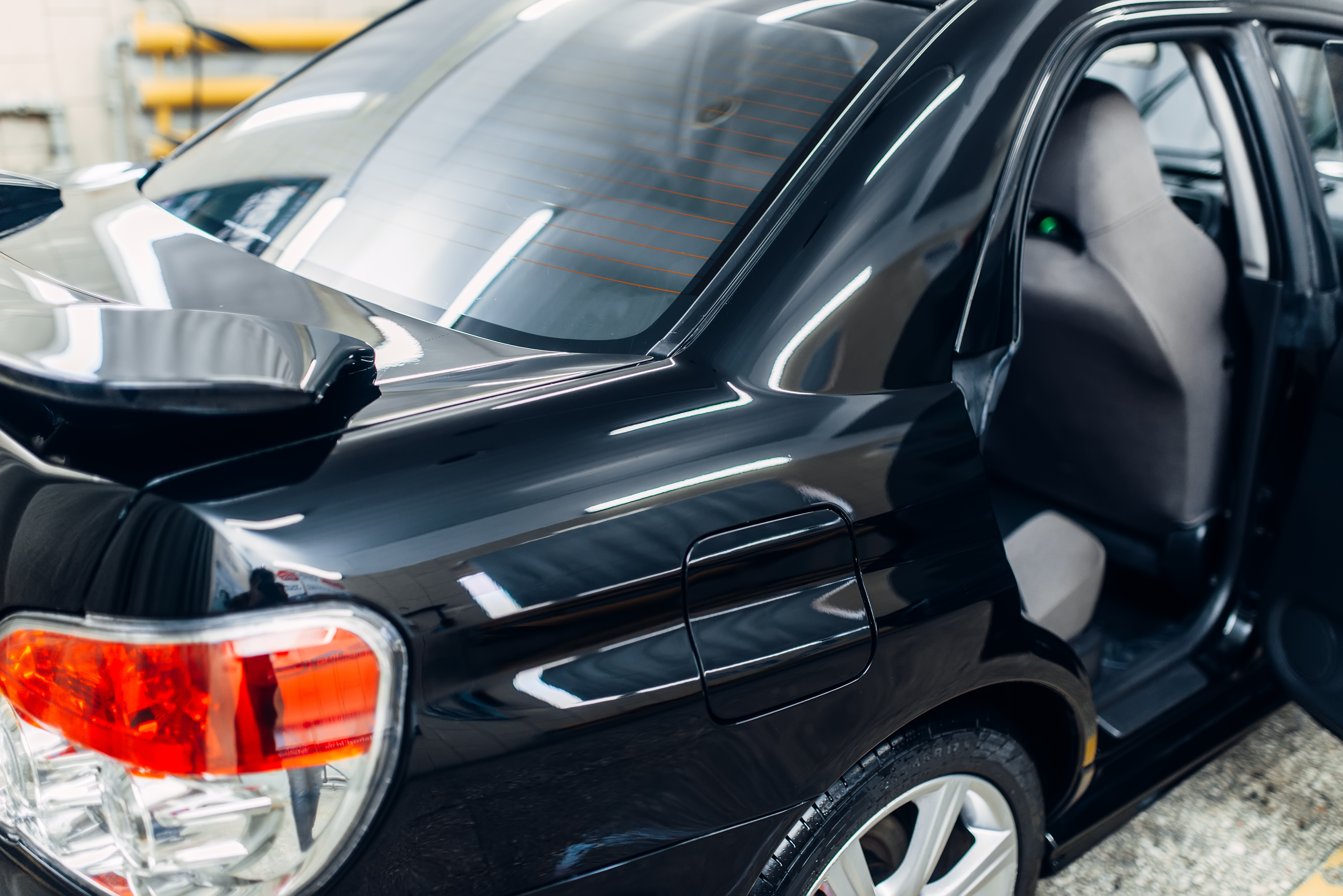 Carwash service, clean car with open doors after washing, nobody. Auto detailing preparation,